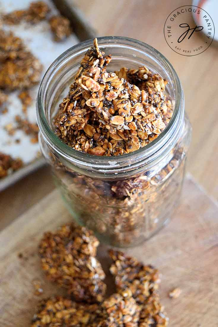 Looking from the top down into a canning jar filled with this Pumpkin Spice Granola Bark.