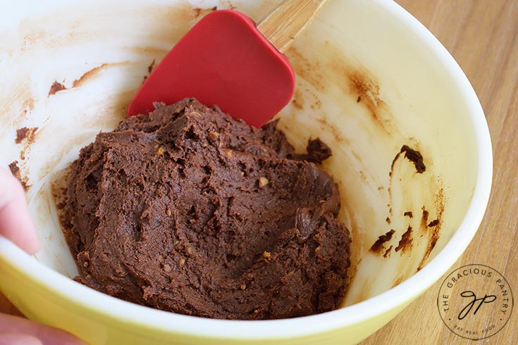 Step one in making these Flourless Brownies is to mix all the ingredients in a medium mixing bowl until well combined.