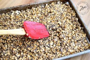 Step eight is to flatten out the surface and compress the oats as much as possible.