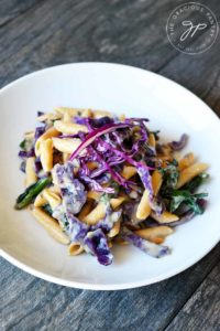 A side view of this Red Cabbage Pasta is a white bowl, ready to serve.