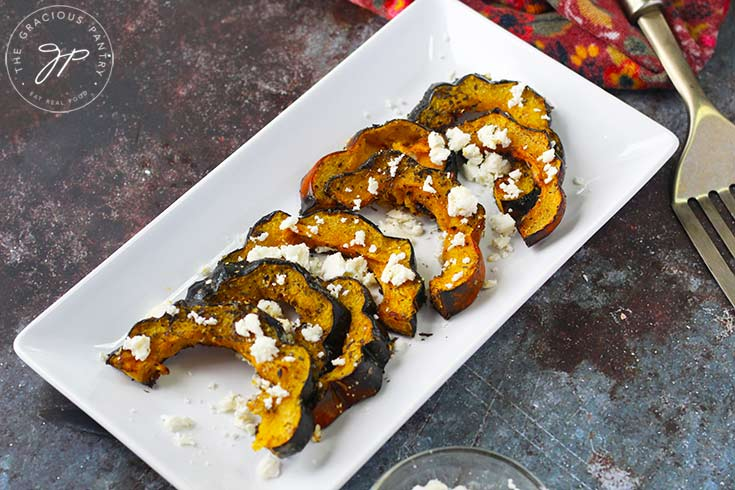 The final step in this Roasted Acorn Squash With Feta recipe is to plate the squash and serve.