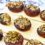 Stuffed Mushrooms sit on a serving tray, ready to serve to guests.