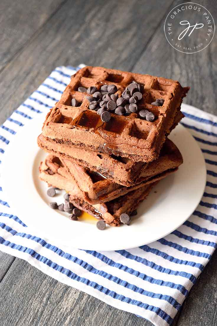 Looking down onto this stack of Vegan Chocolate Waffles topped with vegan chocolate chips.