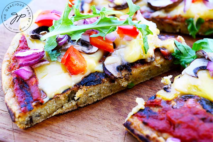 This vegan pizza dough recipe makes a delicious, healthier pizza crust with chickpea flour. A gluten free pizza crust that everyone loves!