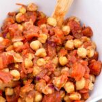 And overhead view looking down into the white serving bowl filled with this Indian Chickpea Salad.