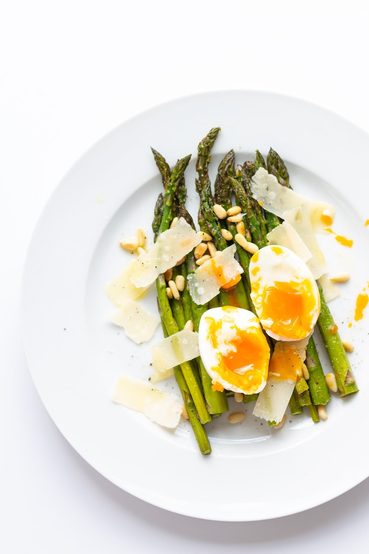 Roasted Asparagus with Egg and Parmesan Salad found in this guide to 15 Clean Eating Easter Recipes