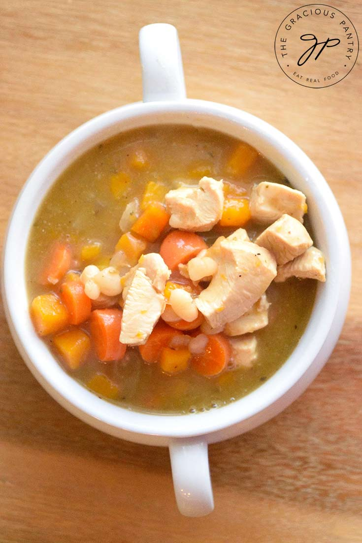 An overhead view looking down into a bowl filled with this Chicken Stew Recipe With Butternut Squash.