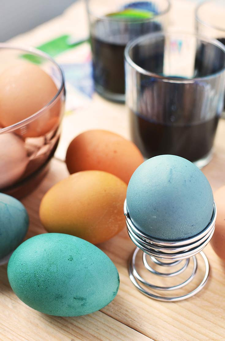 Colorful Easter eggs sit on a counter after just being dyed in this guide to making Homemade Egg Dye For Easter Eggs