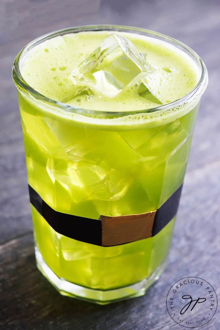 A glass of Green Lemonade sits