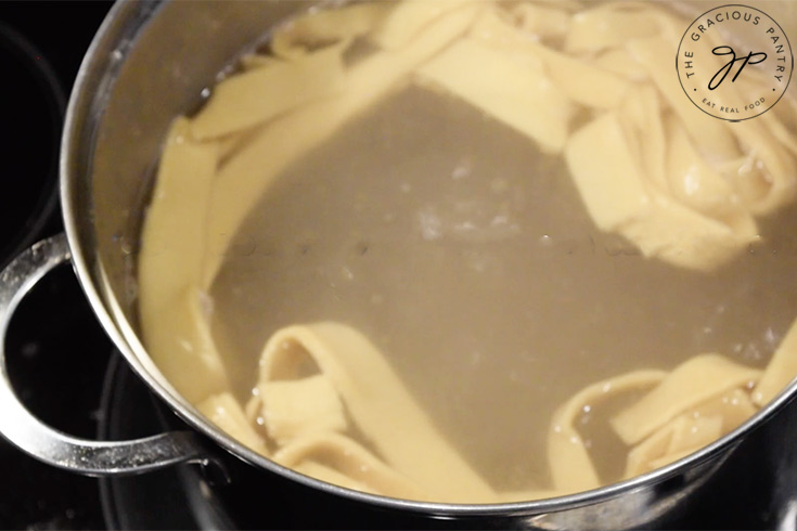 Boil the pasta in salt water for three minutes.