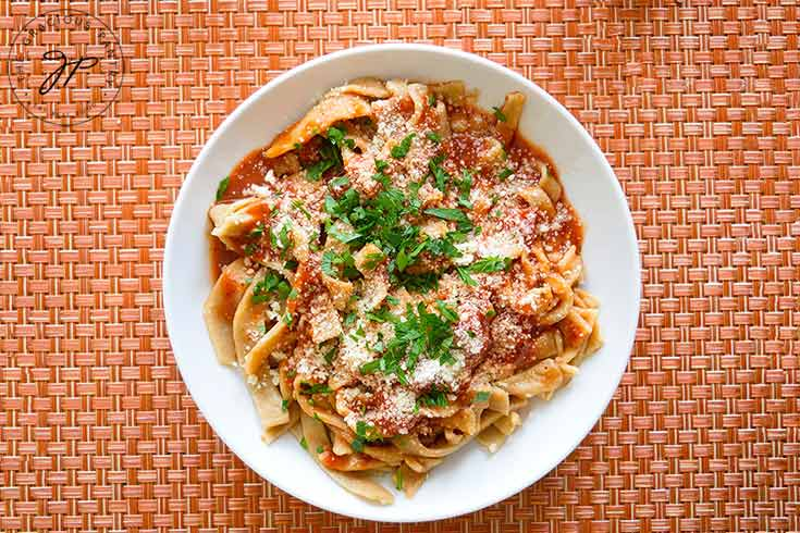 Top the pasta with sauce and serve.