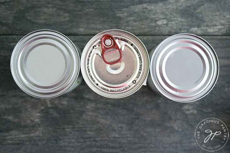 An overhead view of three cans standing in a row.
