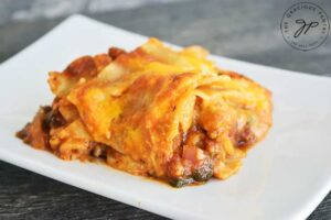 A final slice of this Homemade Lasagna Recipe on a white plate, ready to serve.