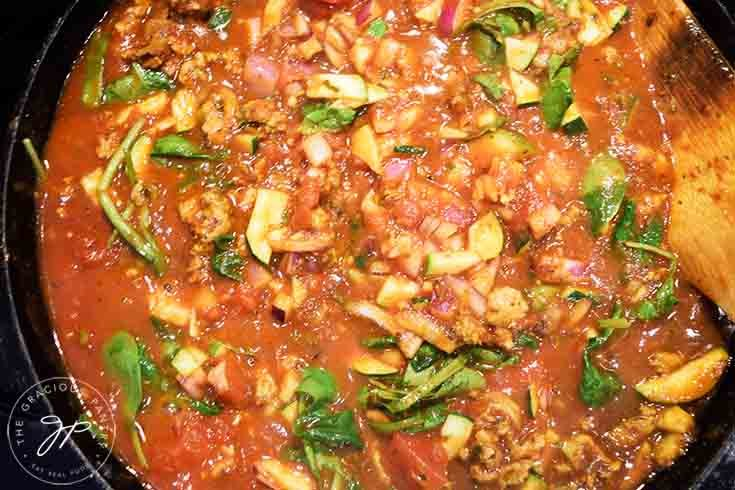 The spinach in the meat filling just barely wilted into the sauce.