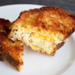 A delicious, golden brown Tuna Melt Recipe, just out of the oven and ready to eat.