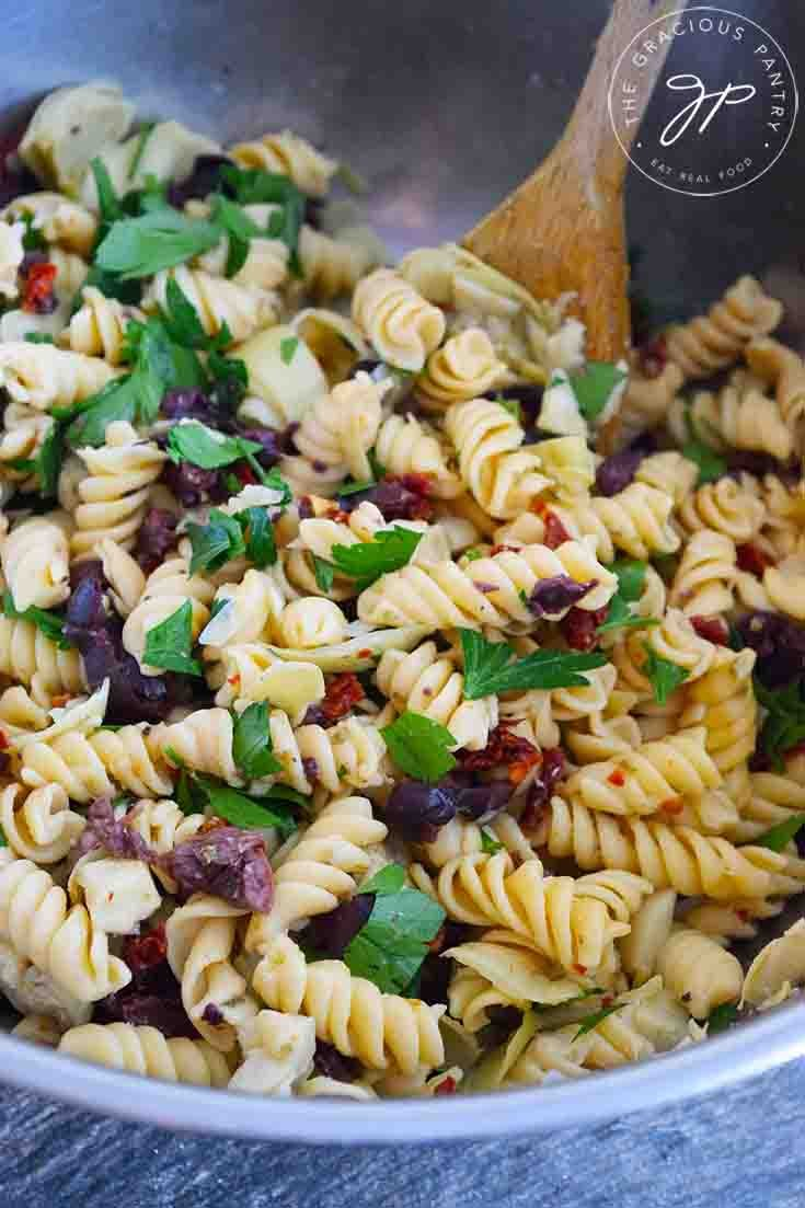 An overhead view of this Greek Pasta Salad Recipe, still in it's mixing bowl, ready to serve.