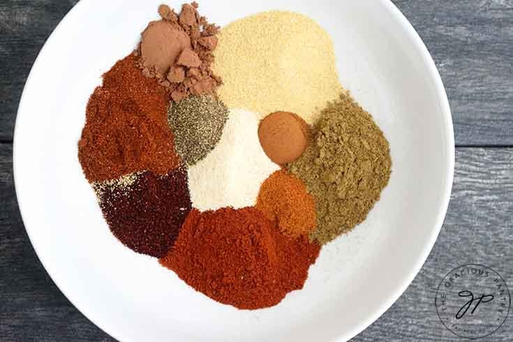 Step one is to add all the spices for this Chili Spice Recipe to a mixing bowl.