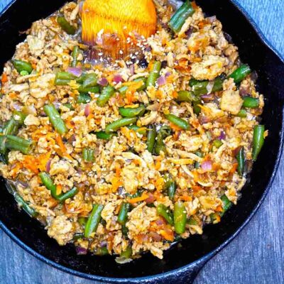 An overhead view of this Teriyaki Turkey Skillet Recipe shows bits of turkey, carrots and green beans all tossed with a delicious teriyaki sauce.