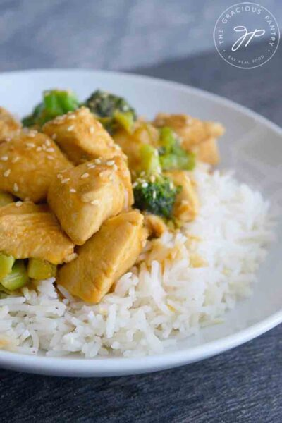 A bowl of this Easy Teriyaki Chicken Recipe served over a bed of rice.