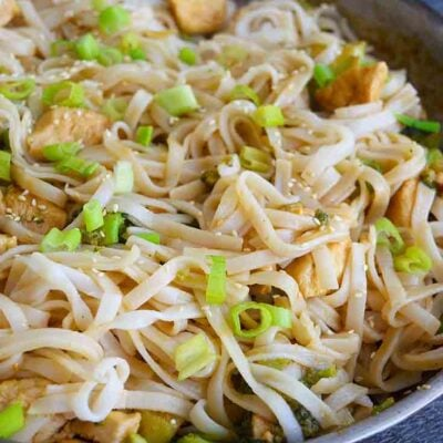 A side view of this Easy Teriyaki Chicken made with rice noodles and still in the skillet.