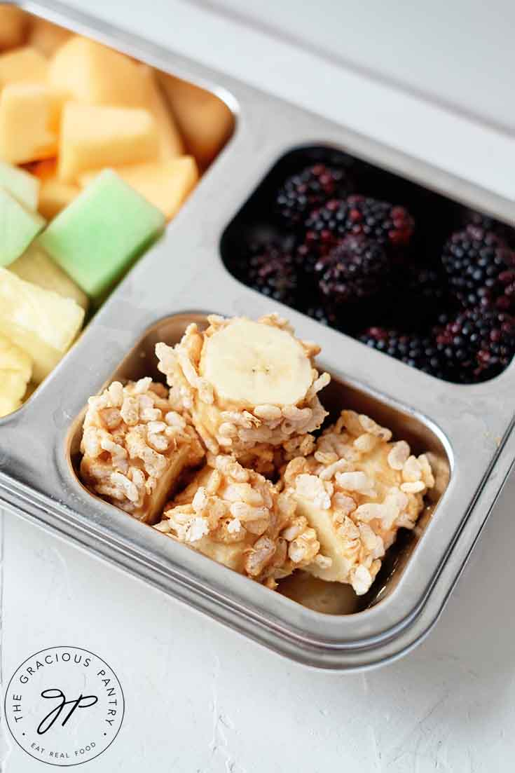Banana poppers in a bento-style lunchbox.
