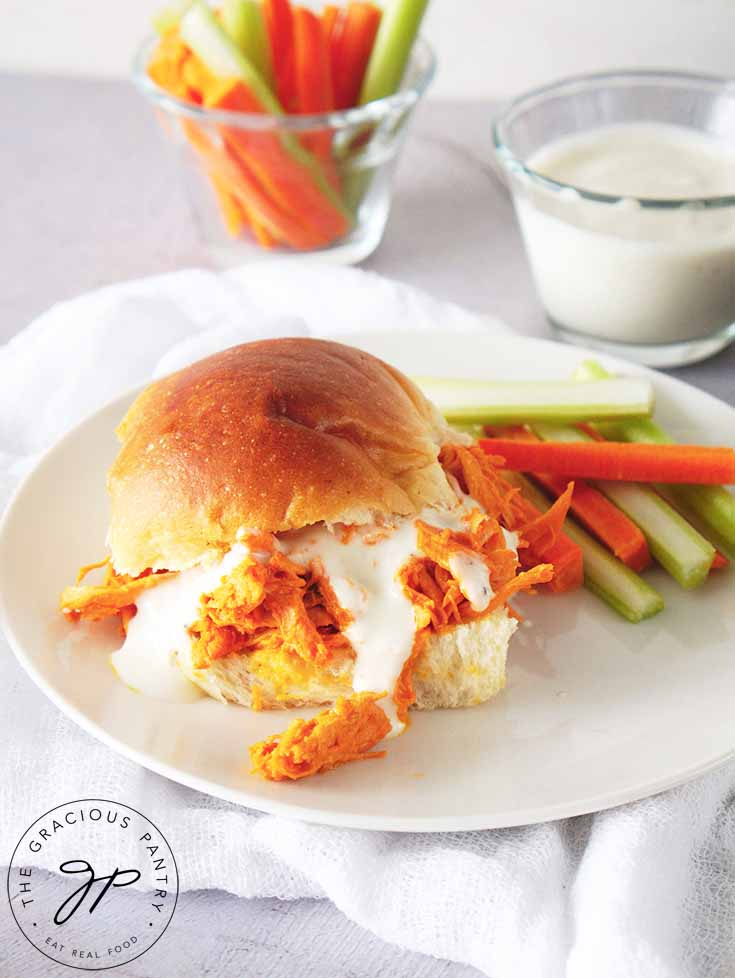 Buffalo Chicken Sandwiches prepared and on a plate with a side of cut veggies