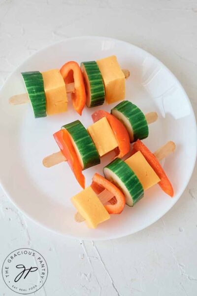 A plate of Cheese Kabobs on a white background.