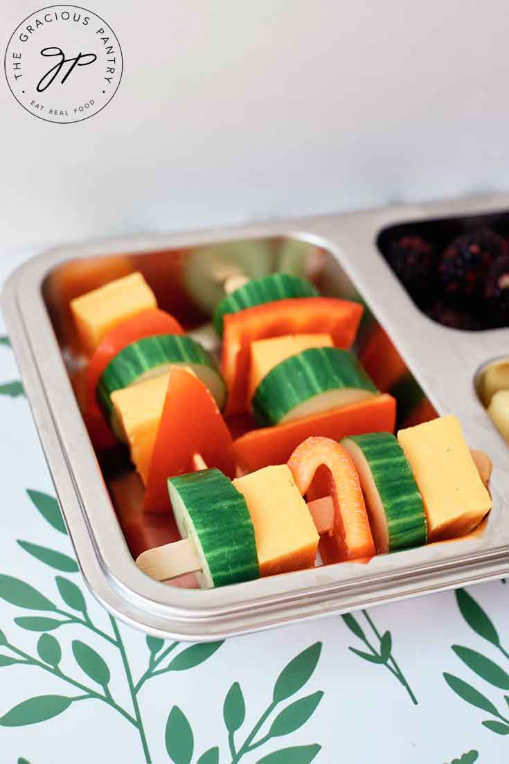 A bento-style lunchbox with Cheese Kabobs in the main compartment.