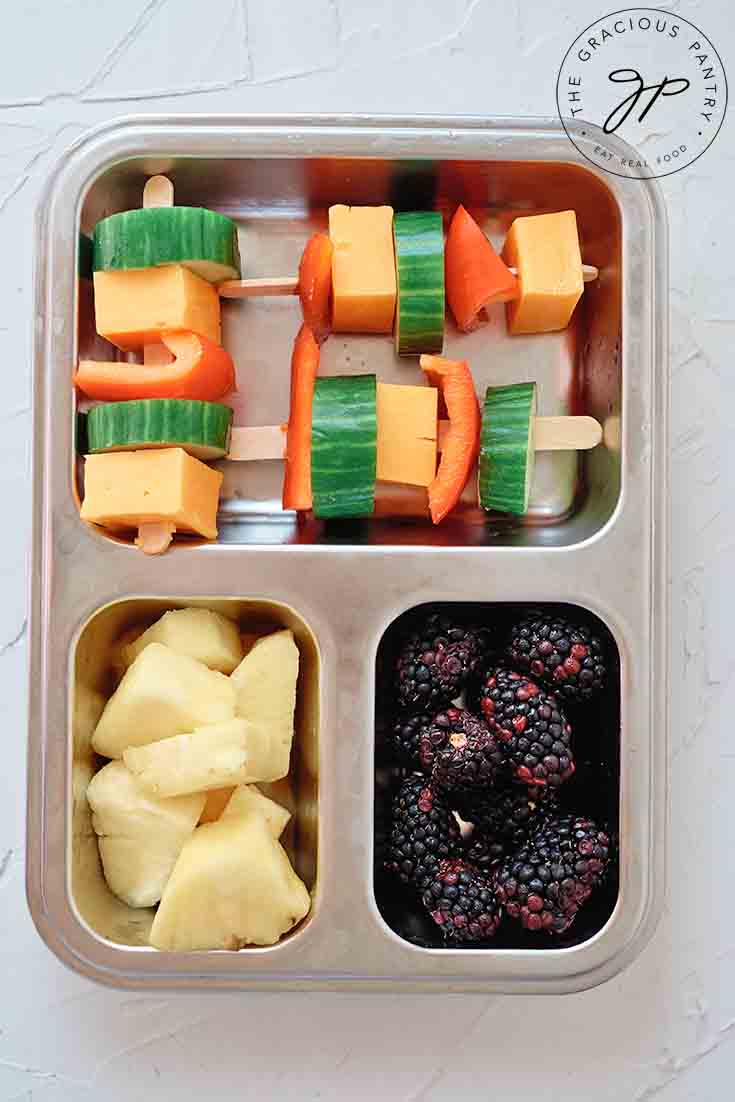 And overhead view of Cheese Kabobs in a bento-style lunchbox.
