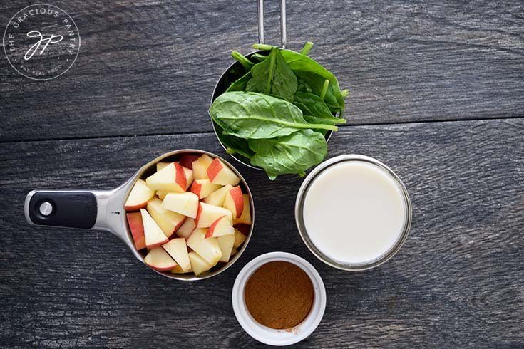Ingredients for this cinnamon apple smoothie recipe sitting in individual measuring cups.