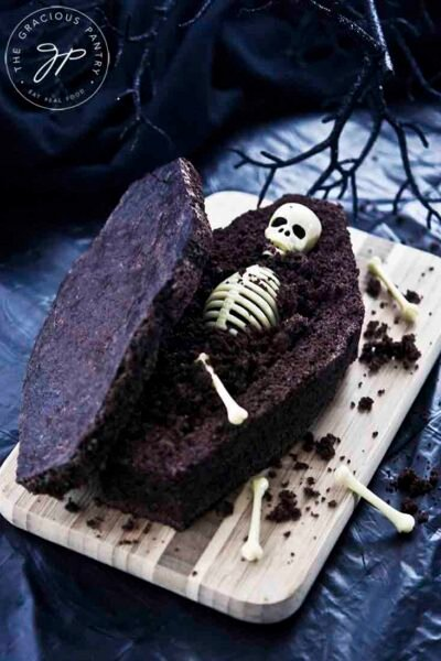 Coffin Bread Recipe - A skeleton lays in a chocolate, sweet bread coffin.