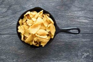 Chips in a skillet waiting for some Nacho Cheese Sauce.