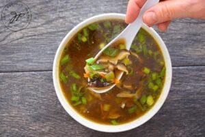 Shiitake Mushroom Soup served in a white bowl.