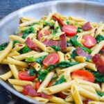 A skillet full of this just-made Baby Kale Pasta Recipe.