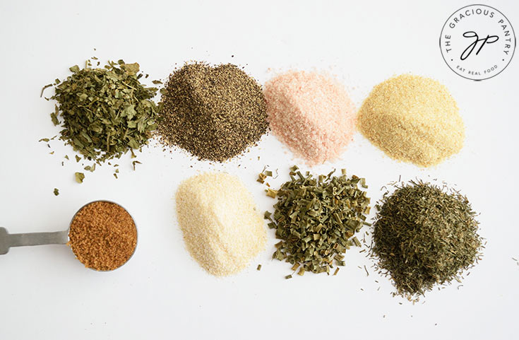 The individual spices in this Ranch Dressing Mix Recipe, in little piles on a white background.