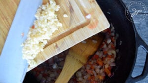 Adding the garlic to the pot.