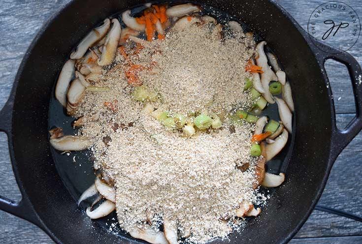 Optional mushroom powder added to pot.