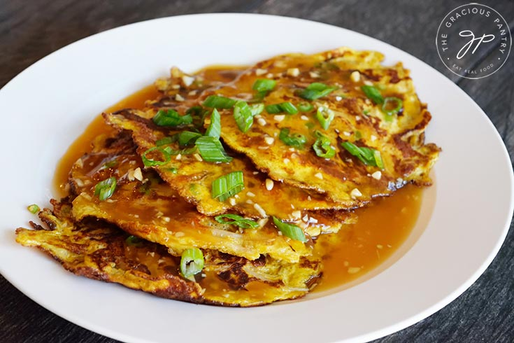 The plated egg foo young, ready to serve and eat.