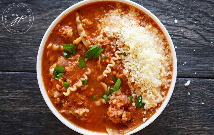 Garnishing the lasagna soup recipe to serve.