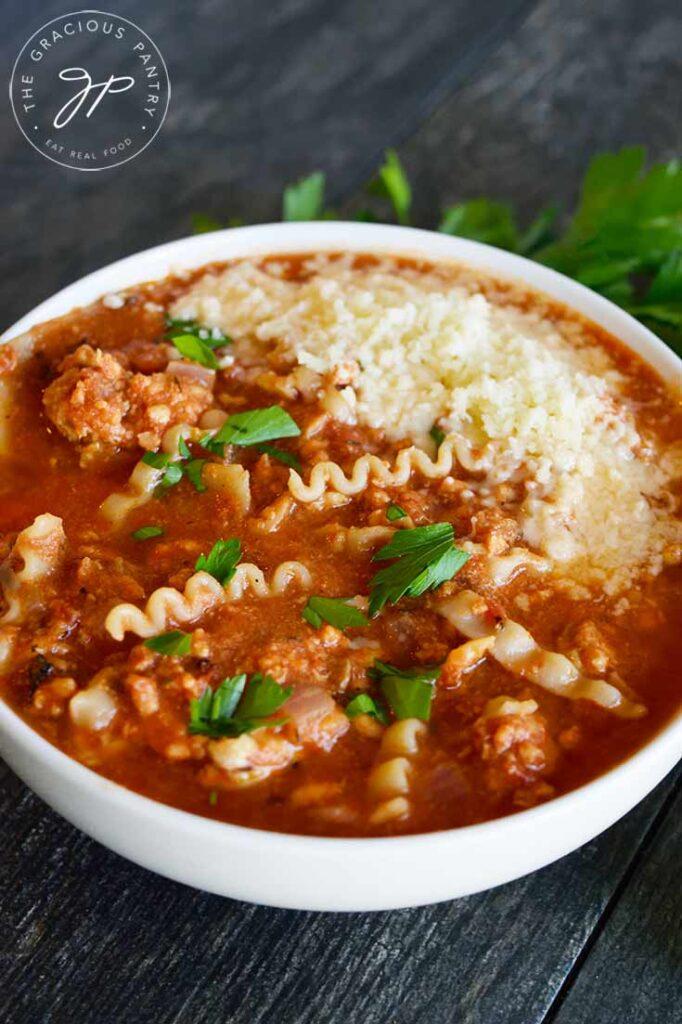 Lasagna Soup recipe in a white bowl.