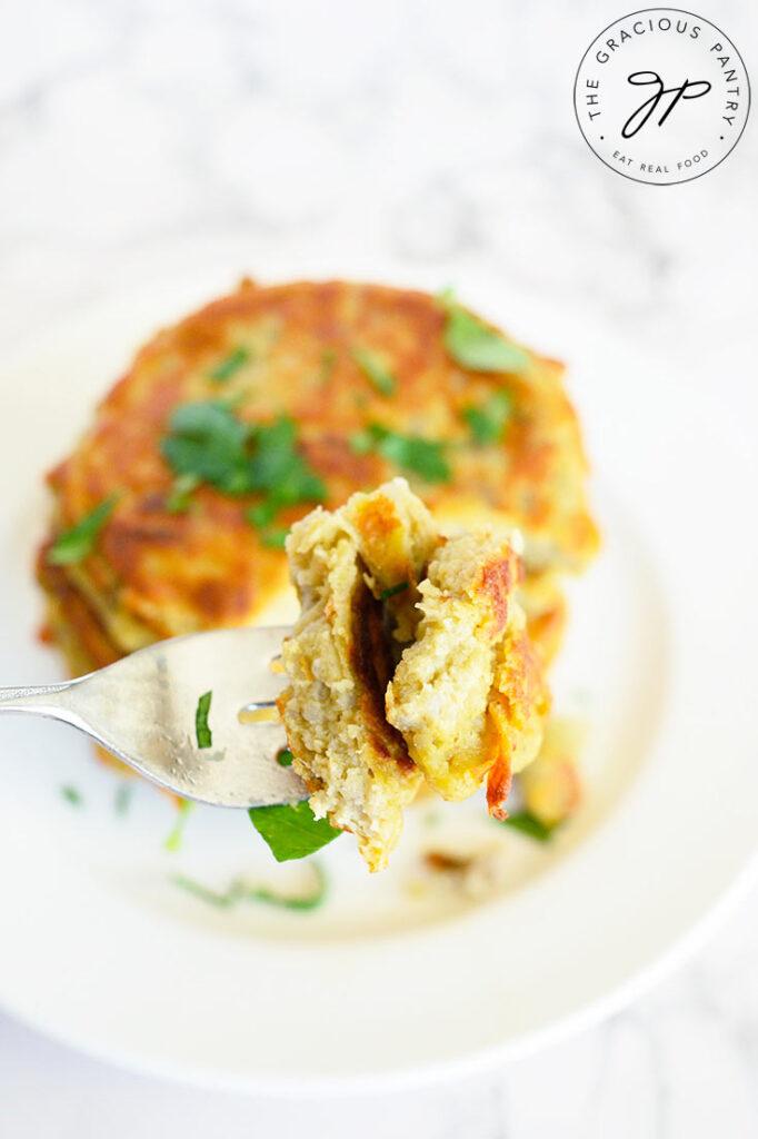 A bite of this Potato Pancake Recipe on a fork, made with this potato pancake recipe.