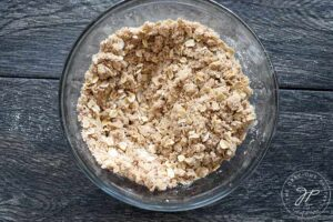 The crumb topping mixed together in a glass bowl.