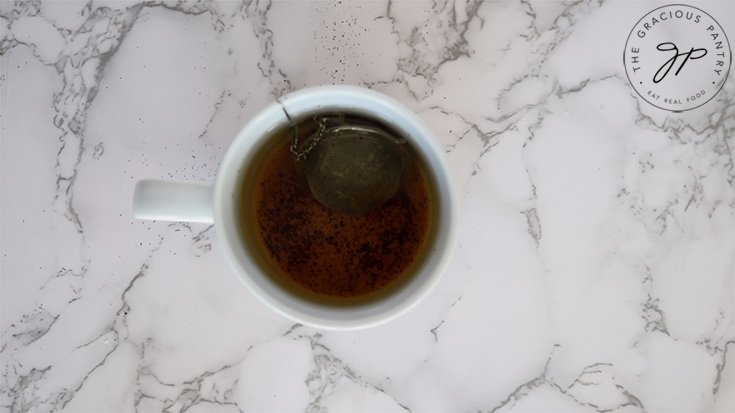 Steeping the tea in a white mug.