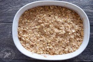 The finished apple crisp, ready to go into the oven for baking.