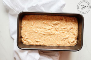 The persimmon bread batter in a loaf pan, ready to bake.