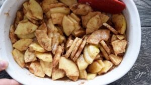 Apples coated with filling ingredients for this apple crisp.