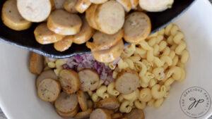 Sautéd sausage added to the pasta.