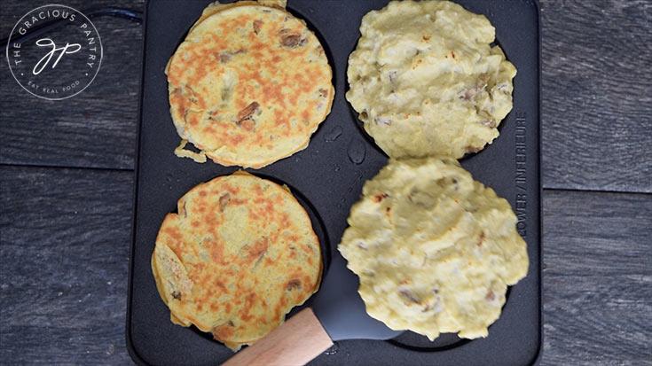 Flipping the potato pancakes on the pan for this Potato Pancake Recipe.