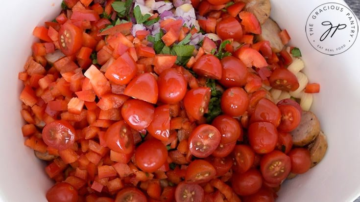 Fresh, halved cherry tomatoes added to the pasta.