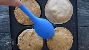 Flipping the pancakes.